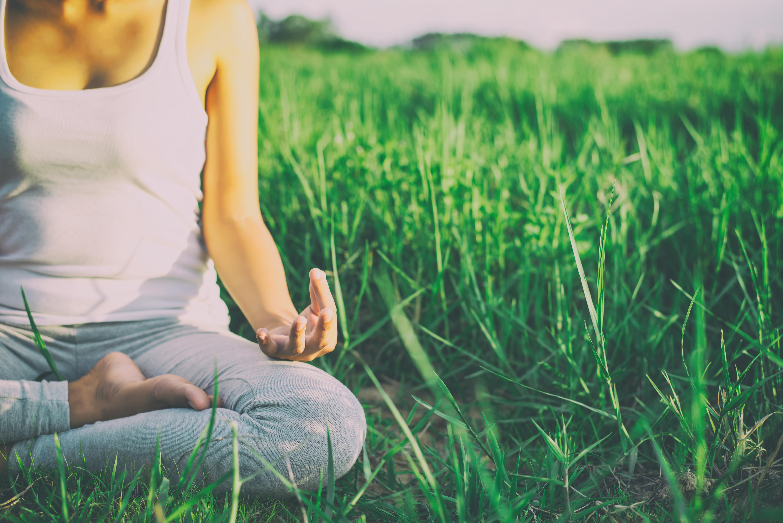 Yoga woman In the lotus posture.